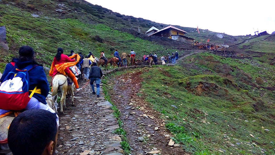 arriving at swami kartikeya temple in himalayas by horse Bharmour himachal pradesh tourism bharmour view min