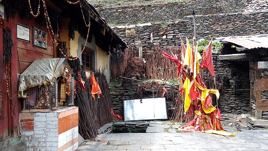trishuls or tridents outside swami kartikeya temple in himalayas kugti bharmour himachal pradesh min